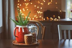 Hot cocoa with marshmallow, fir branches and Christmas decorations on wooden table in country house. Cozy homely scene, danish hygge concept Royalty Free Stock Image