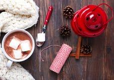 Hot cocoa with marshmallows and Christmas decor Stock Photos