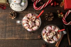 Hot cocoa with marshmallows in a glass cup on a brown wooden background. top view Winter. new Year. Christmas. tree gifts royalty free stock images