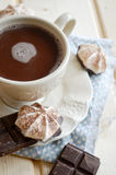 Hot cocoa with marshmallows on wooden table royalty free stock photos