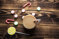 Hot cocoa mint candy holiday. A hot cocoa mint candy holiday wooden background Stock Image