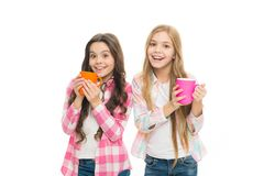 Hot cocoa recipe. Children drink enough during school day. Make sure kids drink enough water. Girls kids hold cups white. Background. Sisters hold mugs stock photos