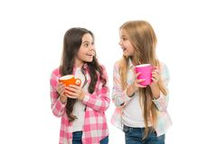 Hot cocoa recipe. Make sure kids drink enough water. Girls kids hold cups white background. Sisters hold mugs. Drinking royalty free stock images