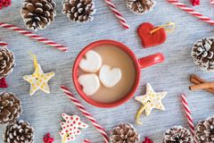 Hot cocoa in red mug with heart marshmallows flat lay arrangement Christmas royalty free stock photos