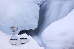 Hot Cocoa For Two. A snowshoeing trip is rimmed with romance as a couple can enjoy hot cocoa for two beside an icy waterfall Stock Image
