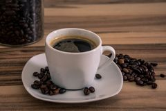 Hot coffe cup with beans stock photos