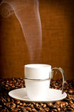Hot coffee. Very Hot coffee and coffee beans Royalty Free Stock Images