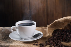 Hot coffee. Cup of black coffee with wood background Stock Photo