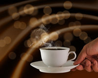 Hot coffee. Hand holds a cup of hot coffee Stock Image