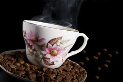 Hot coffee. Hot coffee with coffee beans Stock Photo