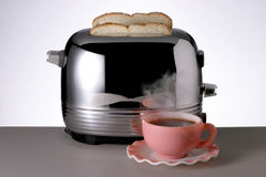 Hot Coffee. Cup of Hot Steaming Coffee ang Toaster royalty free stock images