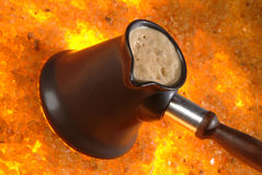 Hot Coffee. Coffee pot on the hot sand royalty free stock photos
