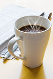 Hot coffee, ball-point and newspaper Stock Image