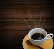 Hot coffee on bamboo mat Royalty Free Stock Photos