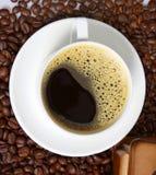 Hot coffee on bean coffee Stock Image