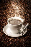 Hot coffee with beans background Royalty Free Stock Photo