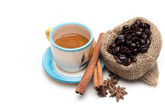 Hot coffee and beans in a bag With cinnamon sticks Royalty Free Stock Photo