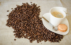 Hot coffee with beans Stock Photos