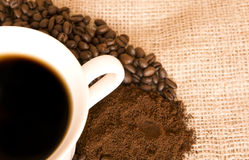 Hot coffee and beans motive Stock Images