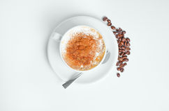 Hot coffee with beans Stock Images