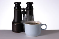 Hot Coffee and Binoculars Royalty Free Stock Photography
