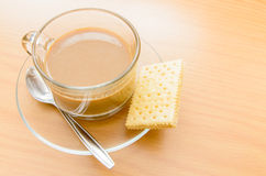 Hot Coffee and biscuit in the morning time Royalty Free Stock Photos