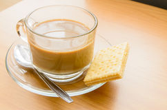 Hot Coffee and biscuit in the morning time Stock Photos