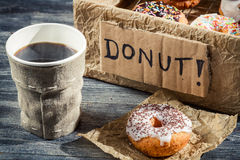 Hot coffee and box with donuts Royalty Free Stock Images