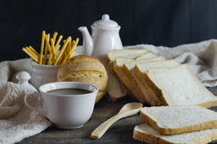 Hot coffee and bread Stock Image