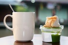 Hot coffee and bread with pandan custard. Thai dessert Royalty Free Stock Photography