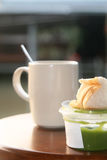 Hot coffee and bread withpandan custard. Hot coffee and bread with pandan custard, Thai dessert Stock Images