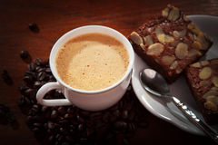 Hot coffee on brownie cake on wood table stock images