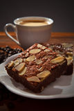 Hot coffee on brownie cake on wood table Royalty Free Stock Photos