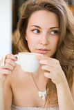Hot coffee brunette lady. Portrait of a romantic looking hot coffee brunette lady Stock Images