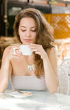 Hot coffee brunette lady. Stock Image