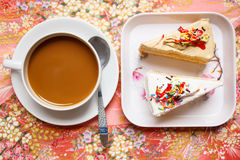 Hot coffee and cake for break. Royalty Free Stock Images