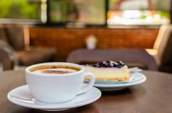 Hot coffee with cake in coffee shop. royalty free stock images