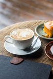 Hot coffee with cake on grunge wood background Stock Photo
