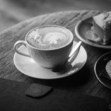 Hot coffee with cake on grunge wood background Stock Images