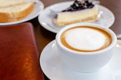 Hot coffee with cake in coffee shop. stock photo