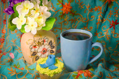 Hot coffee with cakes. Near the vase with flowers royalty free stock images