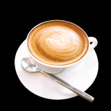 Hot coffee cappuccino cup with spiral milk foam isolated on black background, clipping path included. royalty free stock photography
