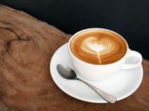 Hot coffee cappuccino latte art top view on wooden table backgro Royalty Free Stock Images