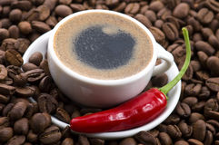 Hot coffee with chili Royalty Free Stock Images