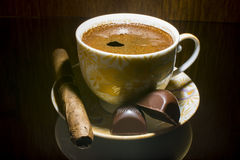 Hot coffee. Coffee , cigar and two chocolate candies royalty free stock image