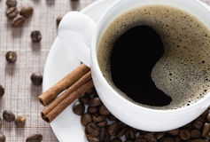 Hot Coffee and Cinnamon Stock Images