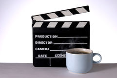 Hot Coffee and Clapperboard. Cup of Hot Steaming Coffee and Clapperboard royalty free stock image