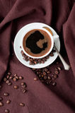 Hot coffee and coffee beans Stock Images