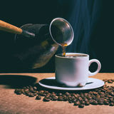 Hot coffee. Coffee grinder, turk and cup of coffee Stock Photos