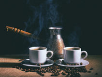 Hot coffee. Coffee grinder, turk and cup of coffee Royalty Free Stock Photos